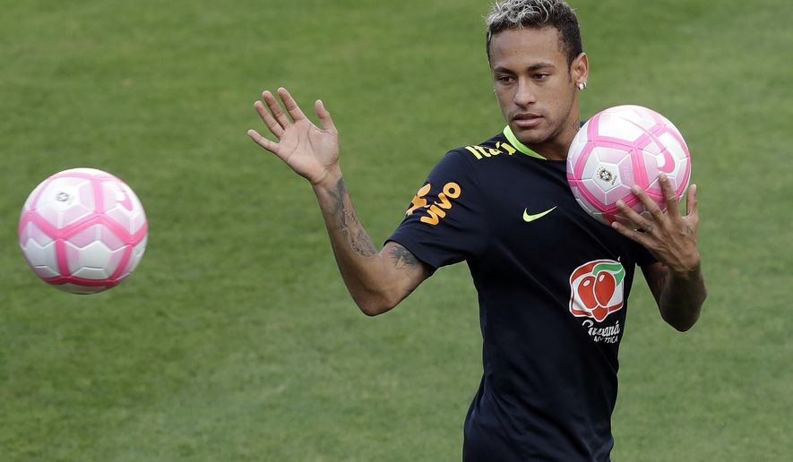 FILE - In this Friday, Oct. 6, 2017 file photo, Brazil's Neymar attends a training session in preparation for an upcoming World Cup qualifying match, in Sao Paulo, Brazil. Neymar will have surgery on a fractured toe in his right foot and could be out for up to three months, an estimate that would take the Brazil striker right up to the World Cup. Neymar was injured Sunday, Feb. 25, 2018 in Paris Saint-Germain's match against Marseille in the French league. (AP Photo/Andre Penner, file)