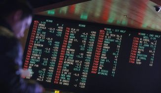 FILE - In this Jan. 14, 2015, file photo, odds are displayed on a screen at a sports book owned and operated by CG Technology in Las Vegas. New Jersey has challenged the Professional and Amateur Sports Protection Act, the 1992 law forbidding all but Nevada and three other states from authorizing gambling on college and professional sports. Only Nevada offers betting on single games. (AP Photo/John Locher, File)