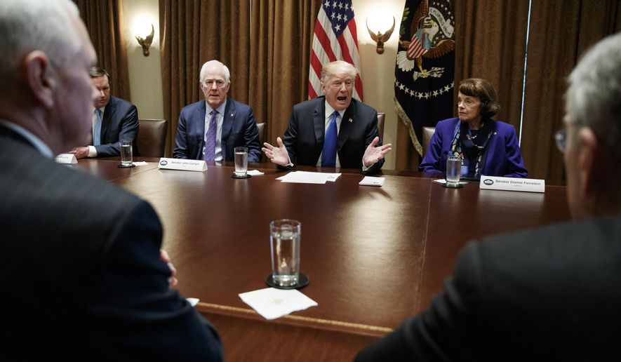 President Donald Trump speaks in the Cabinet Room of the White House, in Washington, Wednesday, Feb. 28, 2018, during a meeting with members of congress to discuss school and community safety. With the president from left, Vice President Mike Pence, Sen. Chris Murphy, D-Conn., Sen. John Cornyn, R-Texas,, the president, Sen. Dianne Feinstein, D-Calif., and Sen. Chuck Grassley, R-Iowa. (AP Photo/Carolyn Kaster)