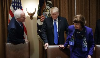 President Donald Trump pulls out a chair for Sen. Dianne Feinstein, D-Calif., right, as Sen. John Cornyn, R-Texas, talks at left, in the Cabinet Room of the White House, in Washington, Wednesday, Feb. 28, 2018, at the start of a meeting with the president and members of Congress to discuss school and community safety. (AP Photo/Carolyn Kaster)
