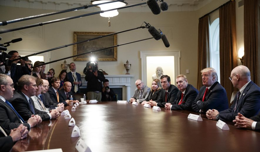 President Donald Trump speaks during a meeting with steel and aluminum executives in the Cabinet Room of the White House, Thursday, March 1, 2018, in Washington. (AP Photo/Evan Vucci)