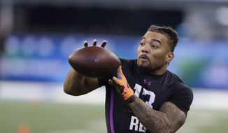 LSU running back Derrius Guice runs a drill during the NFL football scouting combine, Friday, March 2, 2018, in Indianapolis. (AP Photo/Darron Cummings) ** FILE **