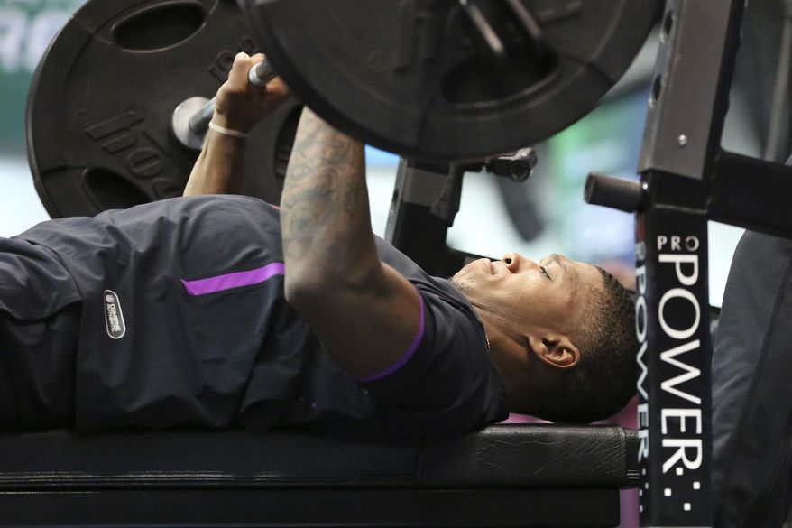 Maryland wide receiver D.J. Moore participates in the Bench Press at the 2018 NFL Scouting Combine on Friday, March 2, 2018, in Indianapolis. (AP Photo/Gregory Payan)