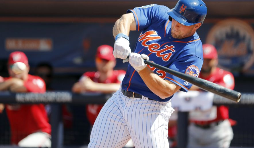 New York Mets' Tim Tebow swings during the second inning of an exhibition spring training baseball game against the Washington Nationals Friday, March 2, 2018, in Port St. Lucie, Fla. (AP Photo/Jeff Roberson)