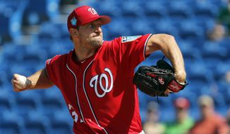 Washington Nationals starting pitcher Max Scherzer throws during the first inning of an exhibition spring training baseball game against the New York Mets Friday, March 2, 2018, in Port St. Lucie, Fla. (AP Photo/Jeff Roberson) **FILE**