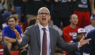 Rhode Island coach Dan Hurley argues a call as his team plays Davidson in the second half of an NCAA college basketball game in Davidson, N.C., Friday, March 2, 2018. (AP Photo/Nell Redmond) **FILE**