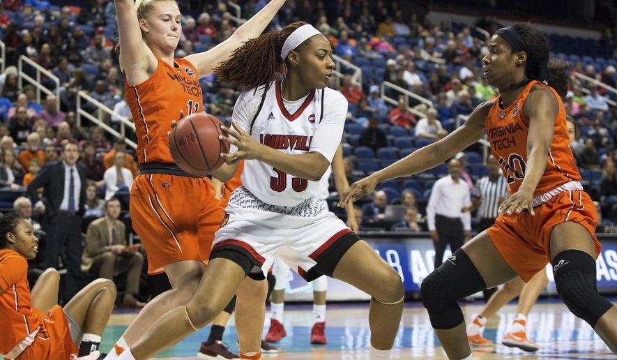 Louisville's Bionca Dunham (33) is handles the ball as Virginia Tech's Regan Magarity (11) and Virginia Tech's Michelle Berry (20) defend during the first half of an Atlantic Coast Conference tournament basketball game in Greensboro, N.C., Friday, Mar. 2, 2018. (AP Photo/Ben McKeown)