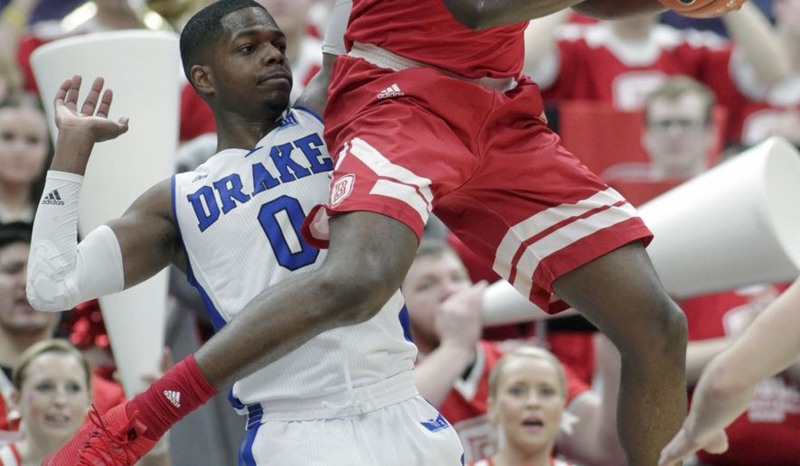 Bradley's Donte Thomas (1) pulls down a rebound in front of Drake's C.J. Rivers (0) during the second half of an NCAA college basketball game in the quarterfinals of the Missouri Valley Conference tournament, Friday, March 2, 2018, in St. Louis. (AP Photo/Tom Gannam)