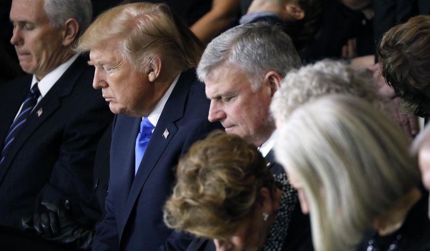From left, Vice President Mike Pence, President Donald Trump, Franklin Graham and the Graham family, pray as the late Rev. Billy Graham lies in honor in the Rotunda of the U.S. Capitol in Washington, Wednesday, Feb. 28, 2018. (Aaron P. Bernstein/Pool via AP)