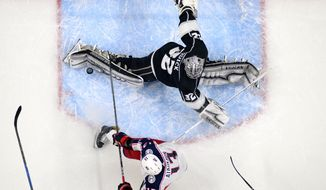 Columbus Blue Jackets right wing Cam Atkinson, below, tries to get a shot past Los Angeles Kings goaltender Jonathan Quick during the second period of an NHL hockey game Thursday, March 1, 2018, in Los Angeles. (AP Photo/Mark J. Terrill)