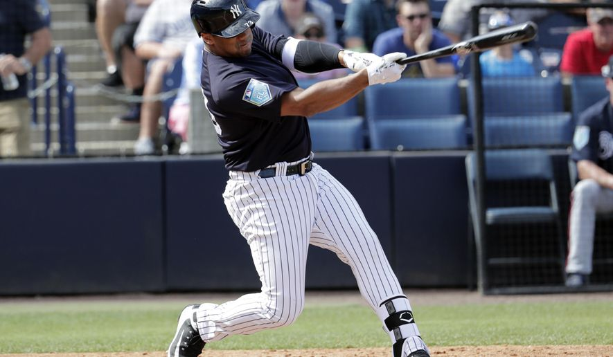 New York Yankees pinch hitter Russell Wilson, a Seattle Seahawks quarterback, strikes out in the fifth inning of a baseball spring exhibition game against the Atlanta Braves, Friday, March 2, 2018, in Tampa, Fla. (AP Photo/Lynne Sladky)