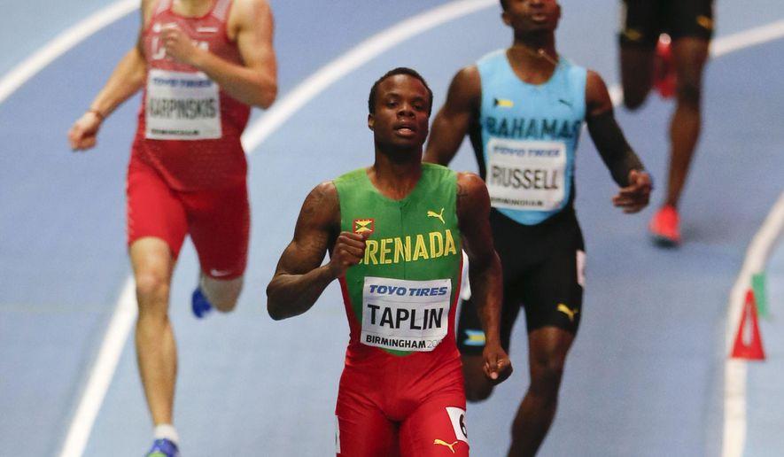 Grenada's Bralon Taplin, center front, leads in a men's 400 meter heat at the World Athletics Indoor Championships in Birmingham, Britain, Friday, March 2, 2018. (AP Photo/Alastair Grant)