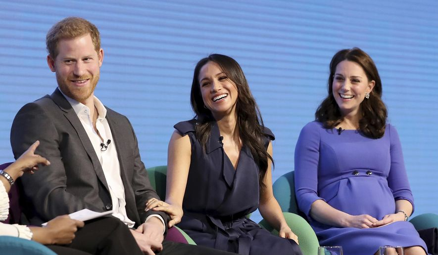 From left, Britain's Prince Harry, Meghan Markle, and Kate, Duchess of Cambridge during the first annual Royal Foundation Forum in London, Wednesday Feb. 28, 2018. Under the theme 'Making a Difference Together', the event will showcase the programmes run or initiated by The Royal Foundation. (Chris Jackson/Pool via AP)