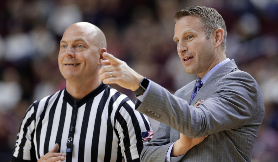 FILE - In this Dec. 21, 2017, file photo, Buffalo head coach Nate Oats talks with a referee during the first half of an NCAA college basketball game against Texas A&M, in College Station, Texas. Nate Oats was credited for doing a remarkable job in leading the University at Buffalo to an NCAA Tournament berth in his first season as coach. Two years later, Oats is showing that wasn't a fluke. (AP Photo/Michael Wyke, File)
