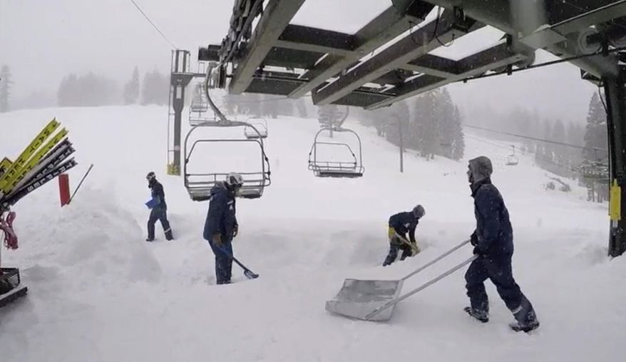 In this image provided by the Kirkwood Mountain Resort, fresh snow is cleared below a ski lift Friday, March 2, 2018, in Kirkwood, Calif. A blizzard warning was in effect for parts of the Sierra Nevada, where snow was piling up and travel was difficult due to repeated highway closures and the need for chains in many places. The snow will help the Sierra snowpack, which is vital to the state's water supply and has only been about a quarter of its normal depth for this time of winter. It's also a boon for skiers and snowboarders. (Kirkwood Mountain Resort via AP)