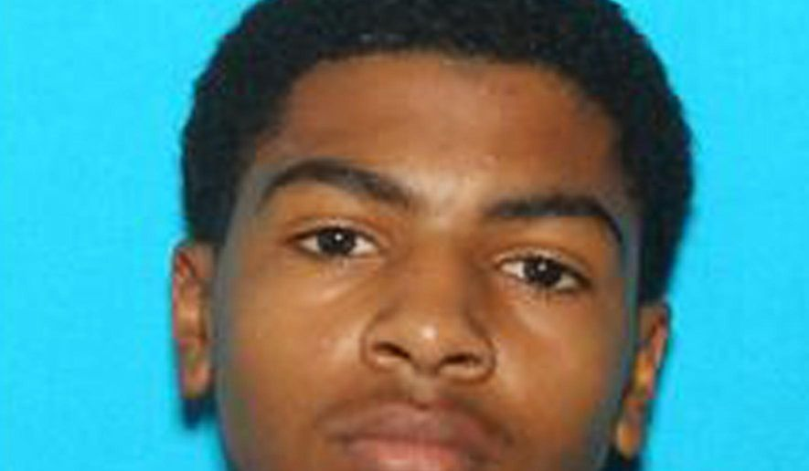 "This undated photo provided by Central Michigan University shows James Eric Davis Jr., who police identified as the shooting suspect at a Central Michigan University residence hall on Friday, March 2, 2018. Investigators said neither victim was a student and described the shooting as a ""family-type domestic situation."" (Courtesy of Central Michigan University via AP)"