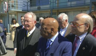 U.S. Rep. John Lewis (D-Ga.), center, speaks while touring the Lorraine Hotel with other Members of Congress in Memphis, Tenn., Friday, March 2, 2018. Next to Lewis is U.S Senator Lamar Alexander (R-Tenn.), left and U.S. Rep. Steve Cohen (D-Tenn.).  Rev. Martin Luther King was assassinated at the hotel on April 4, 1968. Members of Congress are on a three-day pilgrimage to locations with ties to Martin Luther King. (AP Photo/Adrian Sainz)