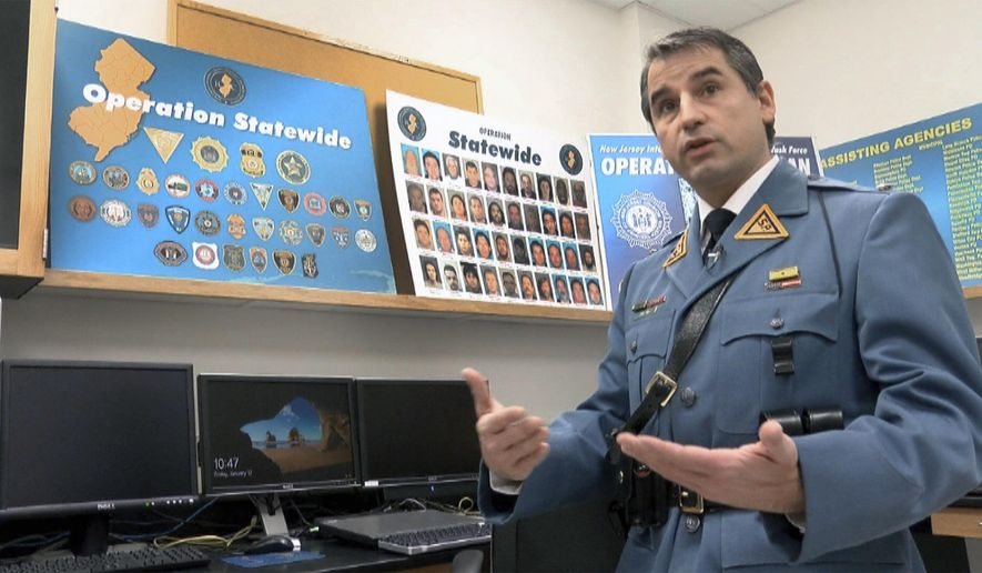 """In this Friday, Jan. 12, 2018 photo, N.J. State Police Lt. John Pizzuro, the commander of the N.J. Regional Internet Crimes Against Children Task Force, is interviewed at the State Police facility in Hamilton Township, N.J. """"Operation Safety Net,"""" the results of which were announced in December, netted 79 people suspected of exploiting children. (Thomas P. Costello/Asbury Park Press)"""