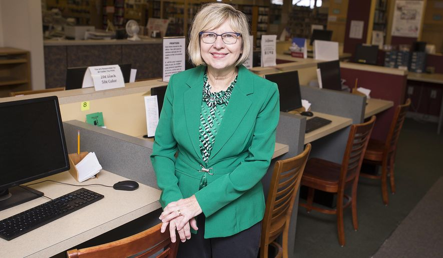 Library director Diane Wakefield stands near a bank of computers at Beaver Area Memorial Library.  For 41 of her 64 years, Wakefield has been director of the Beaver Area Memorial Library. It was her first job and will most likely be her last.   (Kevin Lorenzi /Beaver County Times via AP)