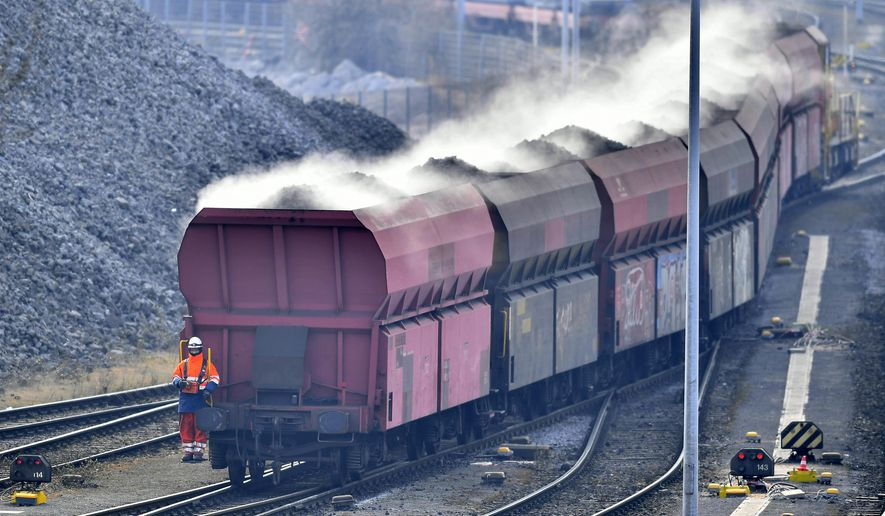 A train brings steaming coke to the Krupp Mannesmann steel factory in Duisburg, Germany, Friday, March 2, 2018. U.S. President Donald Trump risks sparking a trade war with his closest allies if he goes ahead with plans to impose steep tariffs on steel and aluminum imports, German officials and industry groups warned Friday. (AP Photo/Martin Meissner)