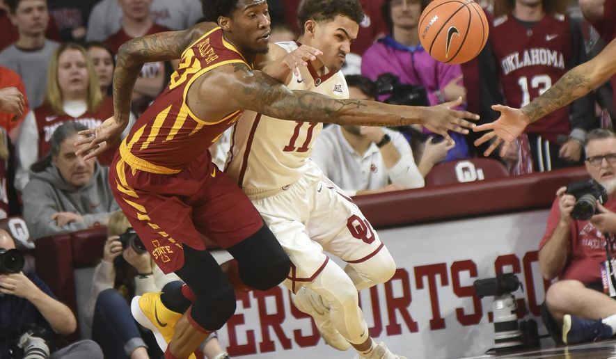 Iowa State's Zoran Talley Jr., left, tries to get to the ball before Oklahoma's Trae Young, right, in the first half of an NCAA college basketball game Friday, March 2, 2018, in Norman, Okla. (AP Photo/Kyle Phillips)