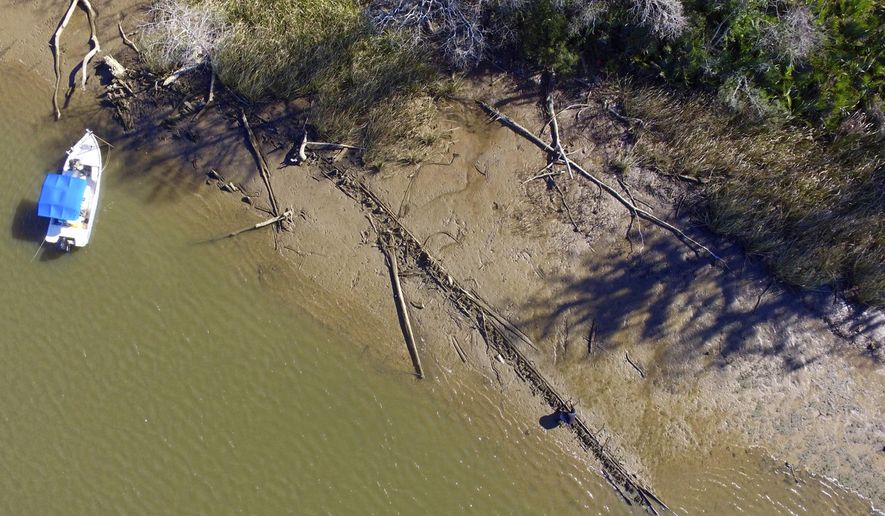 File - This Jan. 2, 2018, file photo shows the remains of a ship that could be the Clotilda, the last slave ship documented to have delivered captive Africans to the United States. The Clotilda was burned after docking in Mobile, Ala., in 1860, long after the importation of humans was banned, and experts say the remains found by a reporter from Al.com could be what is left of the long-lost wreck. (Ben Raines/AL.com via AP, File)