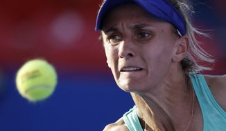 Ukraine's Lesia Tsurenko prepares to hit the ball during her semifinal match against Australia's Daria Gavrilova, at the Mexican Tennis Open in Acapulco, Mexico, Friday, March 2, 2018.(AP Photo/Rebecca Blackwell)