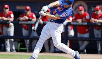 New York Mets' Tim Tebow singles during the fourth inning of an exhibition spring training baseball game against the Washington Nationals, Friday, March 2, 2018, in Port St. Lucie, Fla. (AP Photo/Jeff Roberson)