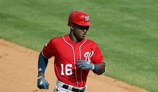 Washington Nationals' Victor Robles rounds the bases after hitting a solo home run during the seventh inning of an exhibition spring training baseball game against the New York Mets Friday, March 2, 2018, in Port St. Lucie, Fla. (AP Photo/Jeff Roberson) **FILE**