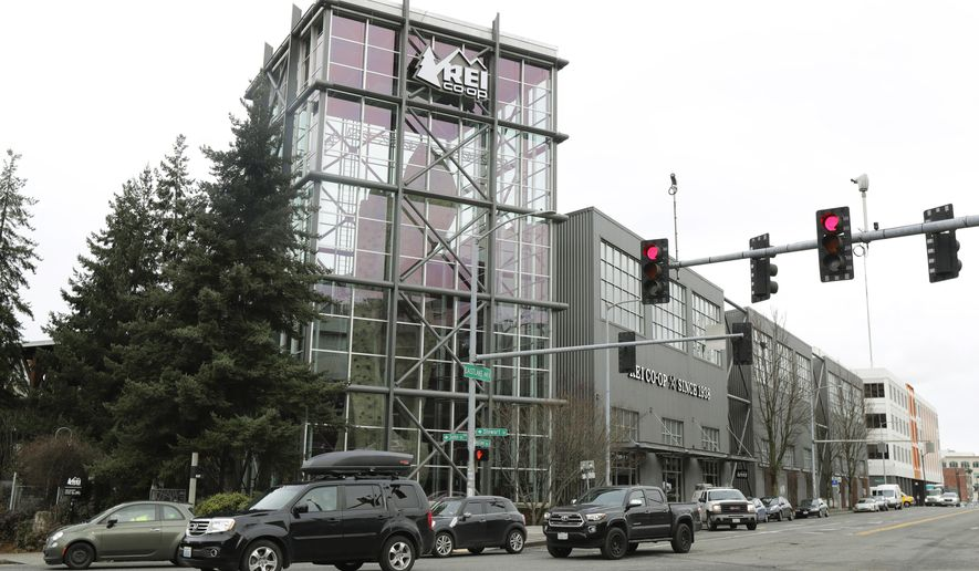 The REI flagship store is shown Friday, March 2, 2018, in Seattle.  The outdoor retailer says it's halting future orders of some popular brands, including CamelBak water carriers, Giro helmets and Camp Chef stoves, whose parent company also makes ammunition and assault-style rifles.  The Seattle-based company has been facing mounting pressure from some customers.  (AP Photo/Ted S. Warren)
