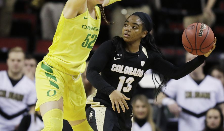 Oregon forward Sierra Campisano, left, defends as Colorado guard Brecca Thomas (13) looks to pass during the second half of an NCAA college basketball game in the quarterfinals of the Pac-12 Conference women's tournament, Friday, March 2, 2018, in Seattle. Oregon won 84-47. (AP Photo/Ted S. Warren)