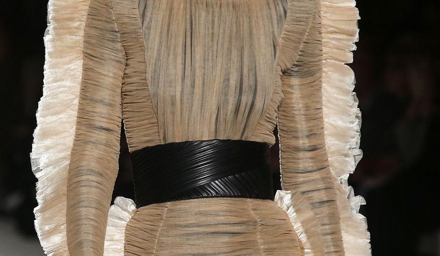 A model wears a creation for Balmain's ready-to-wear fall-winter 2018/2019 fashion collection presented in Paris, Friday, March 2, 2018. (AP Photo/Thibault Camus)