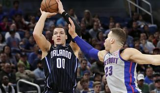 Orlando Magic's Aaron Gordon (00) shoots over Detroit Pistons' Blake Griffin (23) during the second half of an NBA basketball game, Friday, March 2, 2018, in Orlando, Fla. (AP Photo/John Raoux)