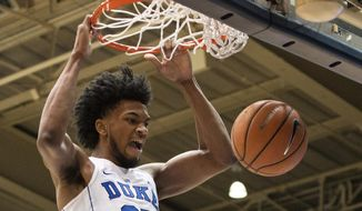 FILE - In this Jan. 27, 2018, file photo, Duke's Marvin Bagley III (35) dunks the ball during the first half of an NCAA college basketball game against Virginia in Durham, N.C. Bagley ranks second in the ACC in scoring and first in rebounding entering the fifth-ranked Blue Devils' regular-season finale against North Carolina.  (AP Photo/Ben McKeown, File)