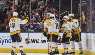 Nashville Predators celebrate a goal against the Edmonton Oilers during the second period of an NHL hockey game Thursday, March 1, 2018, in Edmonton, Alberta. (Jason Franson/The Canadian Press via AP)