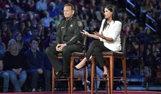National Rifle Association spokesperson Dana Loesch answers a question while sitting next to Broward Sheriff Scott Israel during a CNN town hall meeting, Wednesday, Feb. 21, 2018, at the BB&T Center, in Sunrise, Fla. (Michael Laughlin/South Florida Sun-Sentinel via AP)