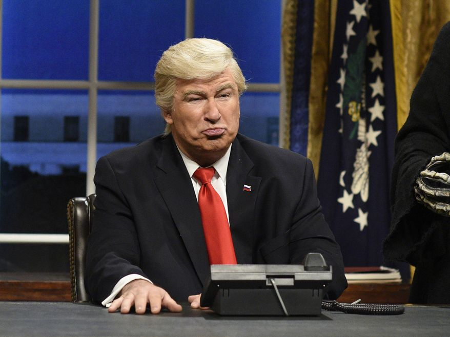 """In this file photo from Feb. 4, 2017, actor Alec Baldwin portrays President Donald Trump in the opening sketch of """"Saturday Night Live"""" in New York. On Sept. 12, 2019, SNL producers announced new cast members joining the program for its 45th season, which premieres on Sept. 28.  (Will Heath/NBC via AP) ** FILE **"""