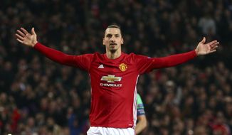 "FILE - In this file photo dated Thursday, Feb. 16, 2017, Manchester United's Zlatan Ibrahimovic celebrates after scoring during the Europa League round of 32 first leg soccer match between Manchester United and St.-Etienne at the Old Trafford stadium in Manchester, England. Zlatan Ibrahimovic is eyeing a chance to play at another World Cup even though the coach of Sweden's national team was convinced that the veteran striker had no desire to return. The 36-year-old Ibrahimovic retired from international soccer after the 2016 European Championship to focus on prolonging his club career. Ibrahimovic says ""the door hasn't been shut to anything."" (AP Photo/Dave Thompson/File)"