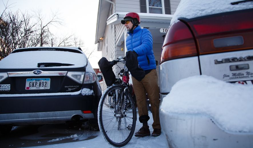 Jeff Wiggins, Des Moines' active transportation planner, rides his bike to work on Wednesday, Feb. 7, 2018, in Des Moines. For the past 11 years Wiggins was working in Cheyenne, Wyoming where he helped plan and execute a system of recreational trails. Now he's in Des Moines to direct the city's multi-modal transportation plans as well as on-street bicycle facilities. (Brian Powers/The Des Moines Register via AP) ** FILE **