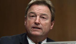 In this Jan. 30, 2018, file photo, Sen. Dean Heller, R-Nev., asks a question of Treasury Secretary Steven Mnuchin during a Senate Banking Committee hearing on Capitol Hill in Washington. (AP Photo/Susan Walsh)