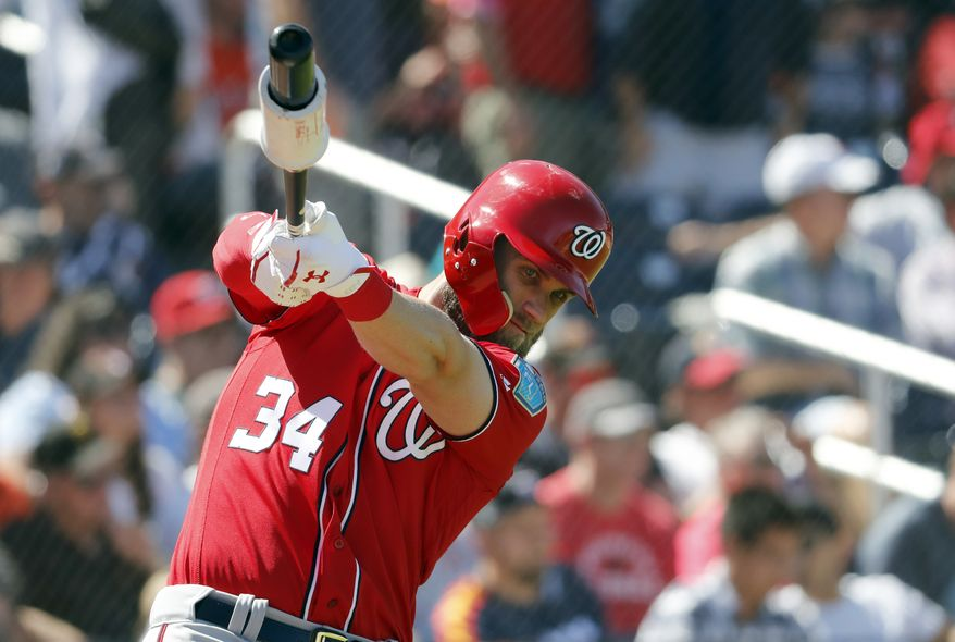 Washington Nationals' Bryce Harper swings in the on-deck circle as he prepares to bat during the fourth inning of an exhibition spring training baseball game against the Houston Astros Saturday, March 3, 2018, in West Palm Beach, Fla. (AP Photo/Jeff Roberson)