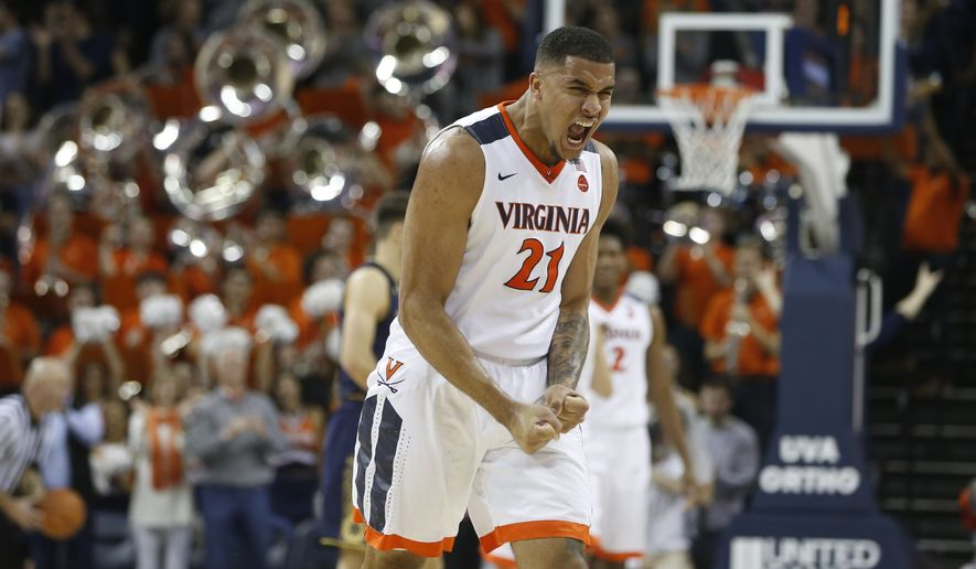 Virginia forward Isaiah Wilkins (21) celebrates his team's 62-57 win at the end of an NCAA college basketball game in Charlottesville, Va., Saturday, March 3, 2018. Virginia won the game 62-57. (AP Photo/Steve Helber) ** FILE **