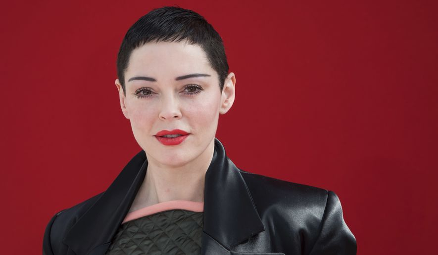 Actress Rose McGowan poses for photographers before the Andreas Kronthaler for Vivienne Westwood ready-to-wear fall/winter 2018/2019 fashion week runway show in Paris, Saturday, March 3, 2018. (Photo by Vianney Le Caer/Invision/AP)