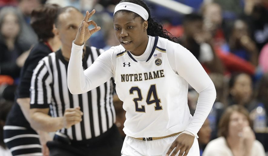 Notre Dame's Arike Ogunbowale (24) reacts after making a basket against Florida State during the second half of an NCAA college basketball game in the semifinals of the women's Atlantic Coast Conference tournament in Greensboro, N.C., Saturday, March 3, 2018. Notre Dame won 90-80. (AP Photo/Chuck Burton)