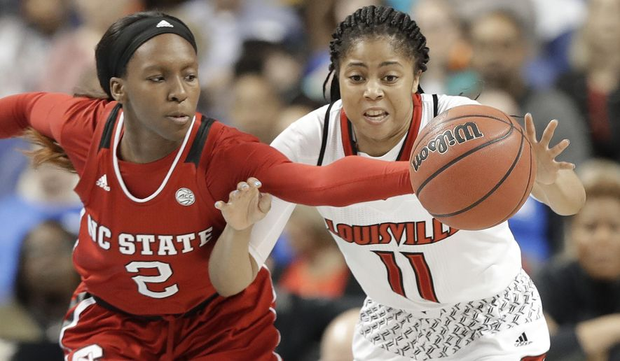 Louisville's Arica Carter (11) and North Carolina State's Kaila Ealey (2) chase a loose ball during the first half of a Women's Atlantic Coast Conference basketball tournament semifinal game in Greensboro, N.C., Saturday, March 3, 2018. (AP Photo/Chuck Burton)