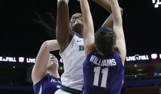Baylor center Kalani Brown, center, shoots between Kansas State center Ashley Ray, left, and forward Peyton Williams (11) in the first half of an NCAA college basketball game in the quarterfinals of the women's Big 12 conference tournament in Oklahoma City, Saturday, March 3, 2016. (AP Photo/Sue Ogrocki)