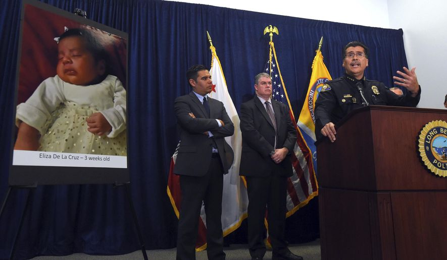 FILE - In this March 25, 2015, file photo, Long Beach Police Chief Robert Luna, right, speaks at a news conference in Long Beach, Calif. On Friday, March 2, 2018, Anthony McCall, a Southern California man, was convicted of killing 3-week-old Eliza De La Cruz, shown in photo at left, in a bizarre child-stealing scheme, according to City News Service. (Scott Varley/Los Angeles Daily News via AP)