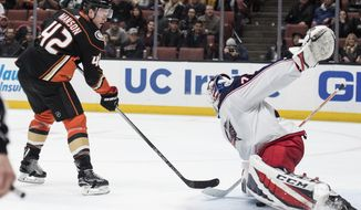 Anaheim Ducks defenseman Josh Manson, left, scores past Columbus Blue Jackets goaltender Sergei Bobrovsky during the second period of an NHL hockey game in Anaheim, Calif., Friday, March 2, 2018. (AP Photo/Kyusung Gong)