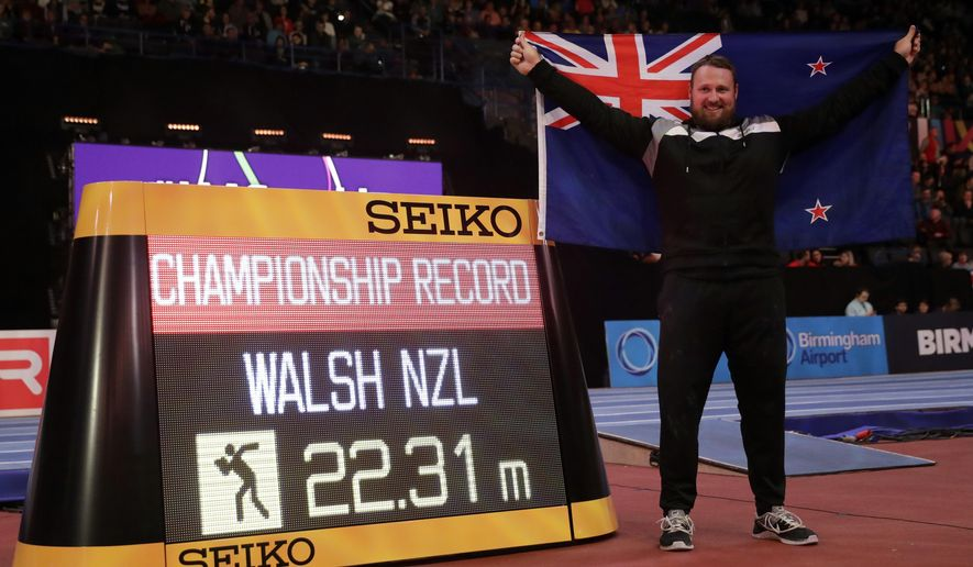 New Zealand's Tomas Walsh celebrates after winning the gold medal and setting a new championship record in the men's shot put final at the World Athletics Indoor Championships in Birmingham, Britain, Saturday, March 3, 2018. (AP Photo/Matt Dunham)