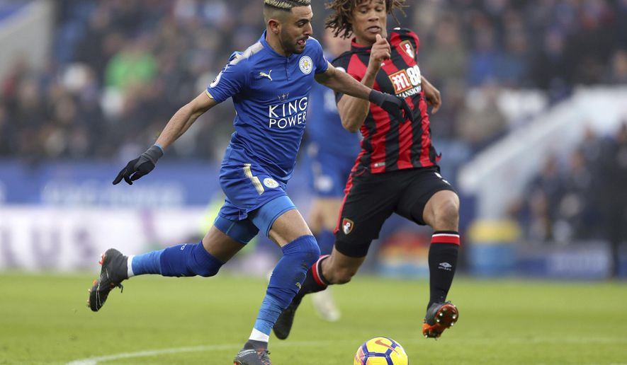 Leicester City's Riyad Mahrez, left, and AFC Bournemouth's Nathan Ake during the English Premier League soccer match at the King Power Stadium in Leicester, England, Saturday March 3, 2018. (Tim Goode/PA via AP)